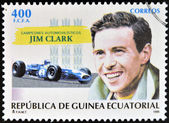 Guiné equatorial - por volta de 1995: um selo impresso na guiné dedicado aos campeões do carro, mostra jim clark, circa 1995 — Foto Stock
