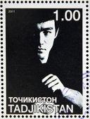 Tajiquistão - circa 2001: selo imprimido no Tajiquistão mostra bruce lee por volta de 2001 — Fotografia Stock