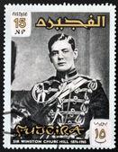 FUJERIA - CIRCA 1966: A stamp printed in Fujeira shows image of sir winston churchil, 1874-1965, circa 1966 — Stock fotografie