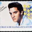 Постер, плакат: EQUATORIAL GUINEA CIRCA 1996: A Stamp printed in Guinea dedicated to cinema shows Elvis Presley circa 1996