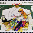 Stock Photo: JERSEY - CIRC1995: stamp printed in Jersey shows Scene from fairy tale Cinderella, circ1965