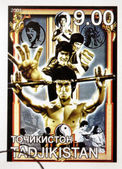 TADJIKISTAN - CIRCA 2001: A stamp printed in Tadjikistan showing Bruce Lee, circa 2001 — Stock Photo