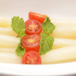 Detail of asparagus with tomato and mint — Stock Photo