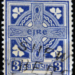 IRELAND-CIRCA 1922: A stamp printed in Ireland shows image of Celtic cross is a symbol that combines a cross with a ring surrounding the intersection, circa 1922. — Stock Photo