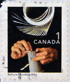CANADA - CIRCA 1999: A stamp printed in Canada, shows bookbinging, circa 1999 — Stock Photo