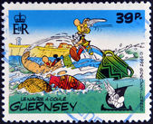 GUERNSEY - CIRCA 1992 : stamp printed in Guernsey shows the ship sinks, belonging to the comic Asterix and Obelix, circa 1992 — Stock Photo