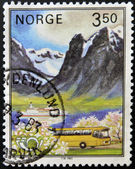 NORWAY - CIRCA 1983: A stamp printed in norway shows tourist bus on a fjord landscape, circa 1983 — Foto de Stock