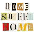 The phrase Home Sweet Home formed with magazine letters on white background — Photo