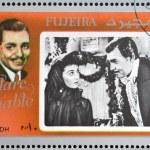Постер, плакат: FUJEIRA CIRCA 1972 : stamp printed in Fujeira shows actor Clark Gable circa 1972