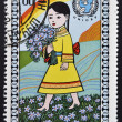 MONGOLIA - CIRCA 1977: stamp printed in Mongolia shows Girl cwith bouquet of flowers, circa 1977 — Stock Photo