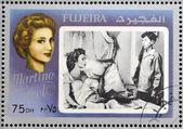Fujeira - circa 1972: selo imprimido em fujeira mostra atriz francesa carol martine, por volta de 1972 — Foto Stock