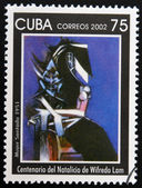 CUBA - CIRCA 2002: A stamp printed in cuba shows woman sitting by Wifredo Lam, circa 2002 — Stock Photo