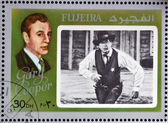 FUJEIRA - CIRCA 1972 : stamp printed in Fujeira shows actor Gary Cooper, circa 1972 — Stock Photo