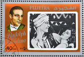 FUJEIRA - CIRCA 1972 : stamp printed in Fujeira shows actor Rudolph Valentino, circa 1972 — Stock Photo