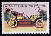 CHAD - CIRCA 1999: A stamp printed in Chad shows vintage car, circa 1999 — Stock fotografie
