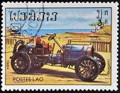 LAOS - CIRCA 1984: A stamp printed in Laos shows retro car, Bugatti, circa 1984. — Foto Stock