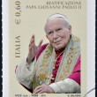 ITALY - CIRCA 2011: A stamp printed in Italy shows an image of Pope John Paul II celebrating his beatification, circa 2011.  — Stock Photo