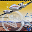 Stock Photo: AUSTRALIA - CIRCA 2001: A Stamp printed in Australia shows the Royal Flying Doctor Service Aircraft and Ambulance, Outback Services, circa 2001