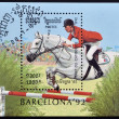 CAMBODIA - CIRCA 1992: A stamp printed in Cambodia dedicated to summer olympic games Barcelona 1992 shows equitation, circa 1992  — Stockfoto