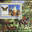 FUJEIRA - CIRCA 1972: A stamp printed in Fujeira shows boy scouts and ornithoptera, circa 1972  — Stock Photo