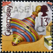 GUERNSEY - CIRCA 1994: A stamp printed in Guernsey dedicated to bygone toys shows a peg-top, circa 1994 — Stock Photo