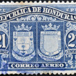 Постер, плакат: HONDURAS CIRCA 1970: A stamp printed in Honduras shows historical shields circa 1970