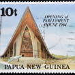 PAPUA NEW GUINEA - CIRCA 1984: A stamp printed in Papua shows opening of parliament house, circa 1984 — Stock Photo #36355931
