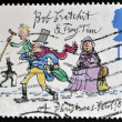 Stock Photo: UNITED KINGDOM - CIRCA 1993: A stamp printed in Great Britain dedicated to Christmas shows Bob Cratchit and Tiny Tim, circa 1993