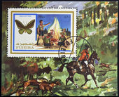 FUJEIRA - CIRCA 1972: A stamp printed in Fujeira shows boy scouts and ornithoptera, circa 1972 — Stock fotografie