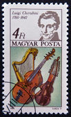 HUNGARY - CIRCA 1985: A stamp printed in Hungary shows Luigi Cherubini and Harp, Bass Viol and Baryton, circa 1985 — Stock Photo