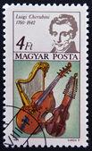 HUNGARY - CIRCA 1985: A stamp printed in Hungary shows Luigi Cherubini and Harp, Bass Viol and Baryton, circa 1985 — Stock Photo