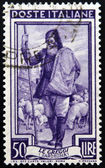 ITALY - CIRCA 1950: a stamp printed in Italy shows Shepherd and Flock, Sardegna, circa 1950 — Stock Photo