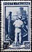 Włochy - ok. 1950: znaczek wydrukowany we włoszech pokazuje obraz z lo scalo (liguria), ok. 1950 — Zdjęcie stockowe