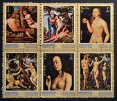 Manama, ajman - cerca de 1971: coleção de selos mostra pinturas adão e eva. série de artes, por volta de 1971 — Fotografia Stock