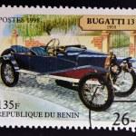 Постер, плакат: BENIN CIRCA 1998: stamp printed in Benin shows retro car bugatti 1910 circa 1998
