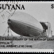GUYANA - CIRCA 1988: A stamp printed in Guyana shows 150th anniversary of the birth of zeppelin, The Graf Zeppelin, Naval Airship LZ 92 (1916), circa 1988 — Stock Photo #38203407