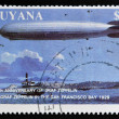 GUYANA - CIRCA 1988: A stamp printed in Guyana shows 150th anniversary of Graf Zeppelin, The Graf Zeppelin in the San Francisco Bay 1929, circa 1988 — Stock Photo #38203419