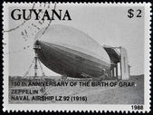GUYANA - CIRCA 1988: A stamp printed in Guyana shows 150th anniversary of the birth of zeppelin, The Graf Zeppelin, Naval Airship LZ 92 (1916), circa 1988 — Foto de Stock