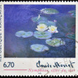 FRANCE - CIRCA 1999: A stamp printed in France shows lilies, evening effect by Claude Monet, circa 1999 — Stok fotoğraf