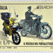 Постер, плакат: ITALY CIRCA 2013: Stamp printed in Italy shows a Moto Guzzi Galletto from 1962 and a modern Piaggio Liberty circa 2013