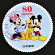 Stock Photo: JAPAN - CIRC2012: stamp printed in Japshows Mickey Mouse, Minnie Mouse and Pluto, circ2012