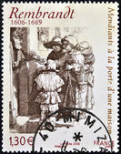 FRANCE - CIRCA 2006: A stamp printed in France shows Beggars receiving alms at the door of a house by Rembrandt, circa 2006 — Stock Photo