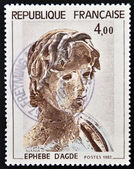 FRANCE - CIRCA 1982: a stamp printed in France shows Young Greek Soldier, Hellenic Sculpture, Agude, circa 1982 — Stock Photo