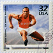 UNITED STATES OF AMERICA - CIRCA 1998: A stamp printed in USA showing an image of Jesse Owens, six world records, circa 1998. — Stock Photo