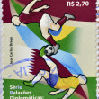 BRAZIL - CIRCA 2011: A stamp printed in Brazil dedicated to diplomatic relations between Brazil and Qatar, shows football, circa 2011 — Stock Photo #40000941