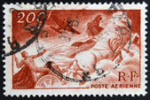 FRANCE - CIRCA 1946: A stamp printed in France shows Apollo on the chariot of the sun, circa 1946 — Stock Photo