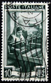 """ITALY - CIRCA 1950: A stamp printed in Italy from the """"Provincial Occupations"""" issue shows a Weaver (Calabria), circa 1950. — Stock Photo"""