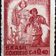 BRAZIL - CIRCA 1945: A stamp printed in Brazil dedicated to to the Allied victory in World War II shows a soldier and young woman personifiyng Glory, circa 1945 — Stock Photo