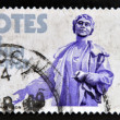 UNITED KINGDOM - CIRCA 1968: A stamp printed in Great Britain dedicated to Granting of votes to women shows Mrs. Emmeline Pankhurst (statue), circa 1968. — Stock Photo #41425225