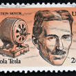 Stock Photo: UNITED STATES OF AMERIC- CIRC1983: stamp printed in USshows Induction motor and portrait of NicolTesla, inventor, electrical engineer and mechanical, circ1983